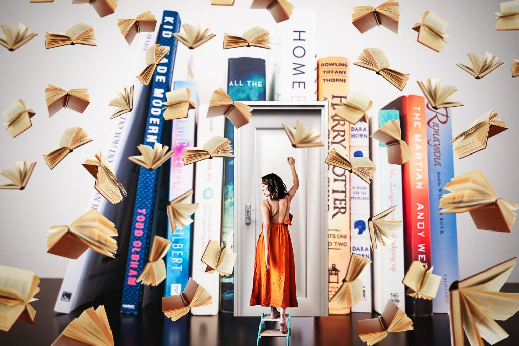 woman surrounded by falling books